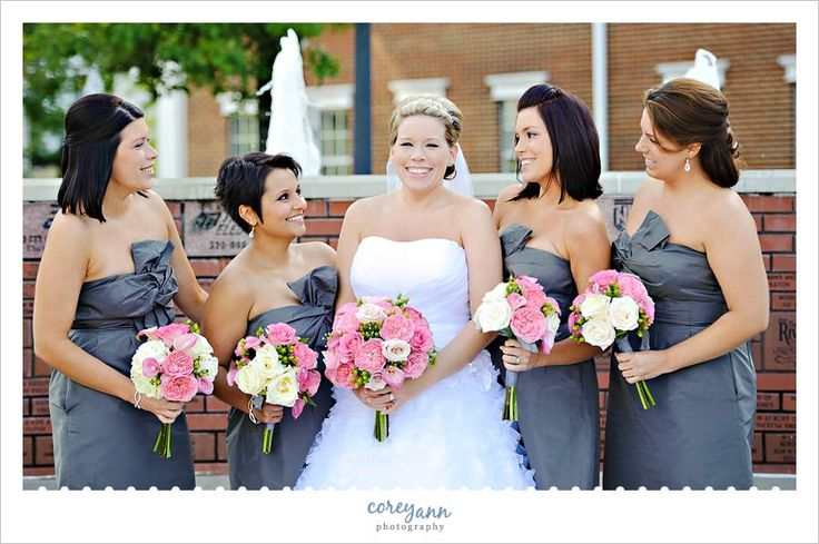 Bridesmaids in grey dresses with pink and white bouquets in ...