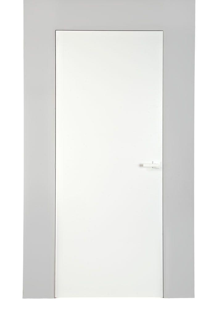 Drzwi Ukryte zlicowane ze ścianą czyli drzwi z ukrytą ościeżnicą. Najnowsze rozwiązania i designerskie trendy. Ekskluzywne i zachwycające drzwi wysokie.