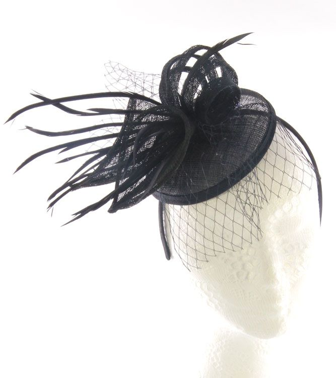 This fascinator has been inspired by the stunning callalily flower, replicated from black sinamay and set onto a headband. Matching black biot feathers have been attached for multi textures, as well as matching black netting.