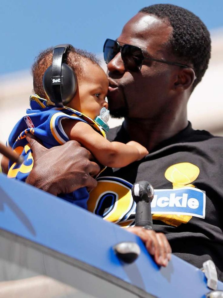 Golden State Warriors' Draymond Green kisses his son, Draymond, Jr., during championship parade on Broadway in Oakland, Calif., on Thursday, June 15, 2017. Photo: Scott Strazzante, The Chronicle