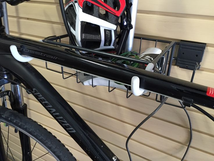 Horizontal slatwall bike hook to hang your bike off the floor and hold accessories