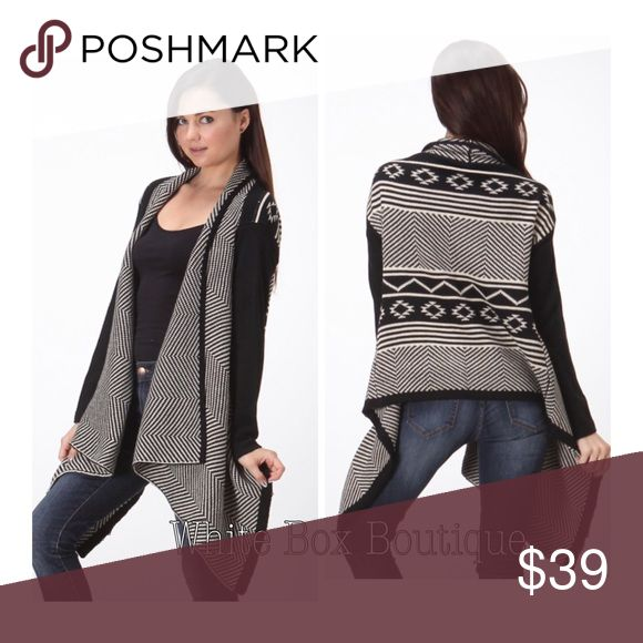 Black & White Print Sweater Cardigan Really gorgeous black & white sweater cardigan with gorgeous Aztec print back. 70%ACRYLIC 20%POLYESTER 10%POLYAMID Sizes Run: Small/Medium & Medium/Large. In my opinion these run smaller, I normally wear a size Small & the Small/Medium fits like a true small. Sweaters Cardigans