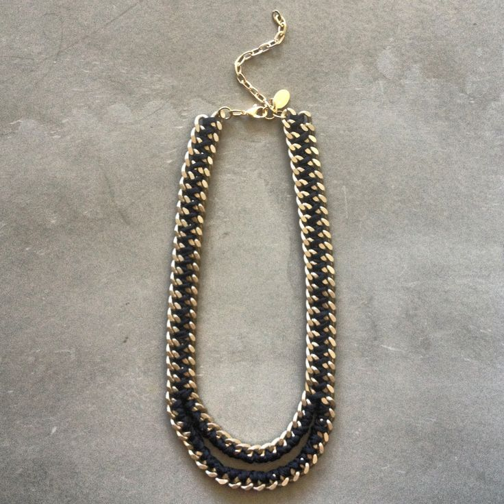 The Mouth necklace in black and matte gold chain by Hermina wristwear and more