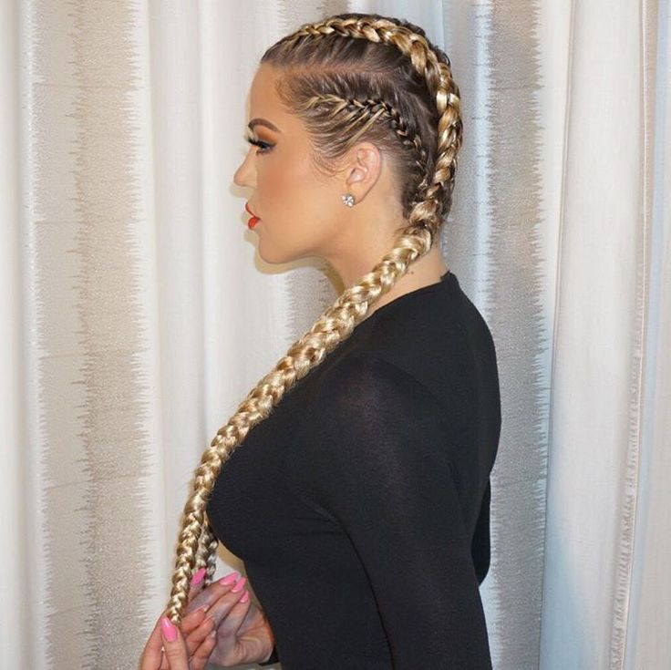 """Had to get KhloMoney back todayBraided by @shidacoiffeur and face beat by @styledbyhrush"""