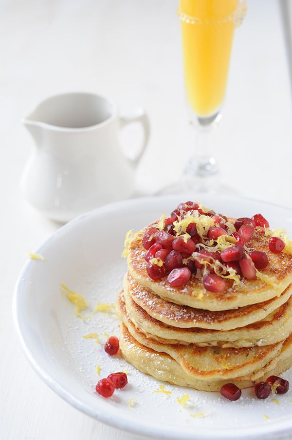 Gluten-Free Lemon Ricotta Pancakes topped with pomegranate seeds and ...