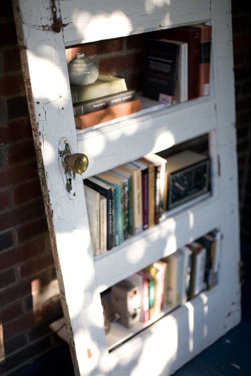 Here's another DIY door bookcase idea.  This one would work great with old wood or glass panel doors.  salvage doors. vintage doors. diy projects. interior design. doors.