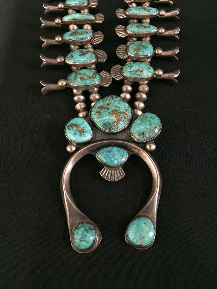 It has a combination of ingot and sheet silver used on it. Circa 1950s - 60s. It features hand made sterling silver beads and it's Navajo in style, however there is no maker's hallmark (which is common of Native Americanjewelry made in the early 1970's and prior ).   eBay!