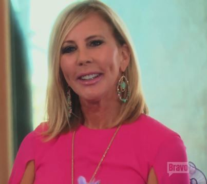 Vicki Gunvalson's Pink Cape Dress & Earrings | http://www.bigblondehair.com/real-housewives/rhoc/vicki-gunvalsons-pink-cape-dress-earrings/