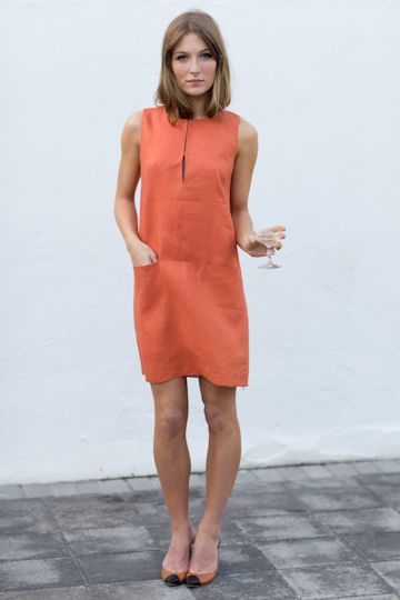 Pretty orange shift dress. I might like Emerson Fry only because all of the models have a drink in their hand...