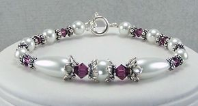 This beautiful birthstone bracelet contains amethyst Swarovski crystals, white glass based pearls, white teardop glass based pearls, sterling silver caps, and sterling silver beads.  Bracelet measures 7 1/2 inches.