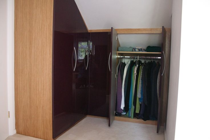 Storage solutions for a loft conversion, finished with oak veneered carcasses and violet acrylic fronts. All manufactured to size in our Basingstoke Workshop. www.harmonymadetomeasure.co.uk