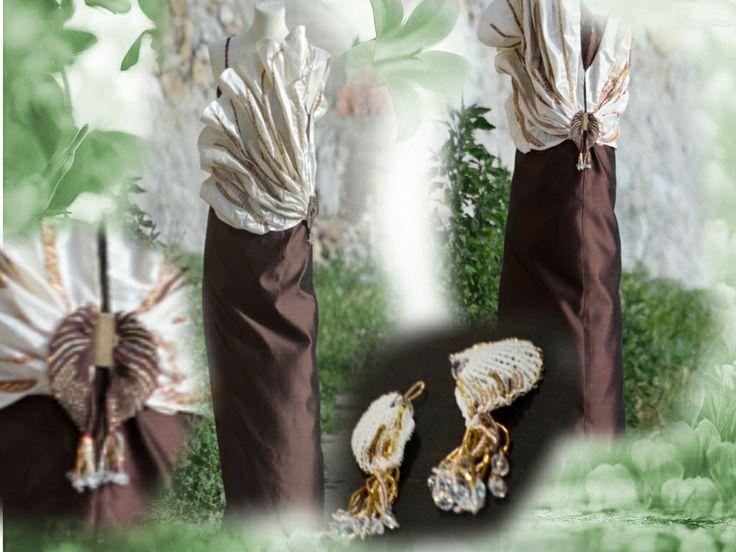 Abito in taffetà color cacao con drappeggio a conchiglia ricamato ed elemento decorativo laterale a macramè.