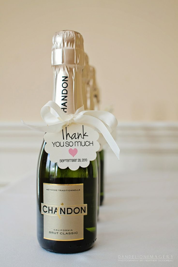 Mini champagne bottles wrapped in tulle with a gold ribbon-wedding ...