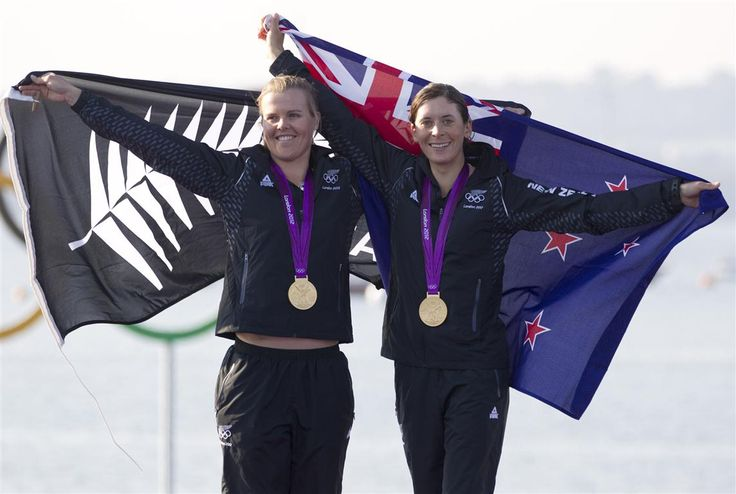 New Zealand's Jo Aleh, left, and Olivia Powrie jubilant after receiving their gold medal in the Women's 470 class yachting. New Zealand Herald/Mark Mitchell