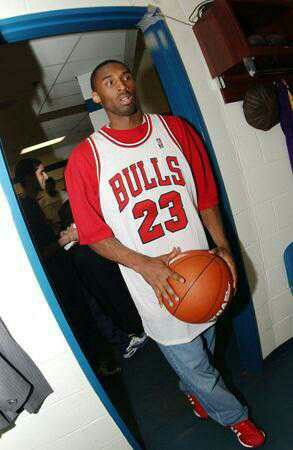 b40b58c9079f85 Young Kobe Bryant wearing a white Michael Jordan Bulls home jersey ...