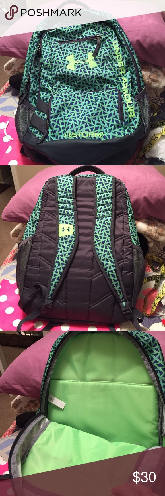 Like new Under Armour backpack green Like new used only a few times Under Armour Backpack with area for laptop cushion , 3 zip pockets for personal stuff on the outside.  Made of Polyester to repel rain, also 2 water bottle areas.  18 inches by 14 inches by 8 inches. Under Armour Bags Backpacks