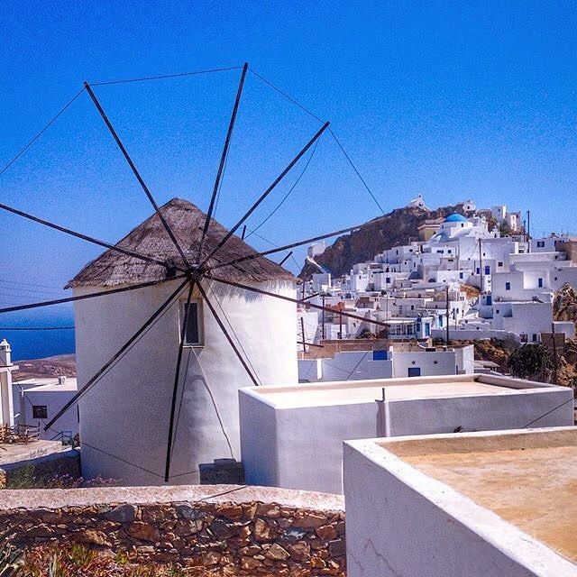 Traditional Cycladic architecture at Chora village , in Serifos island (Σεριφος). Windmill , white houses , blue sky and blue sea .... So beautiful view !