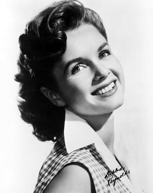 Debbie! Sweet, adorable, and a lovely voice. Not like a Kathryn Grayson/Jane Powell/Shirley Jones soprano voice, but wholesome and clear, perfect for her.
