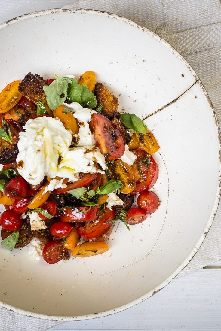 Nina Parker's vibrant Caprese salad recipe is elevated to a thing of beauty with the addition of a flavourful anchovy dressing, the perfect twist to this classic dish.