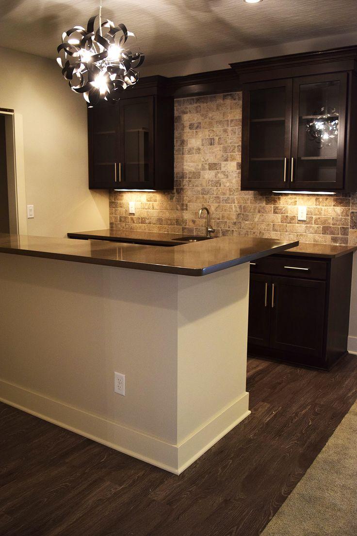Create a great space for entertaining! Do a modern bar design makeover with hardwood flooring and stone backsplash. | Basement Bar Ideas | Home Decor Ideas | Interior Design