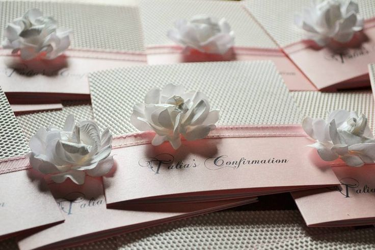 TALIA- pink bifold invite with white embossed paper and flower