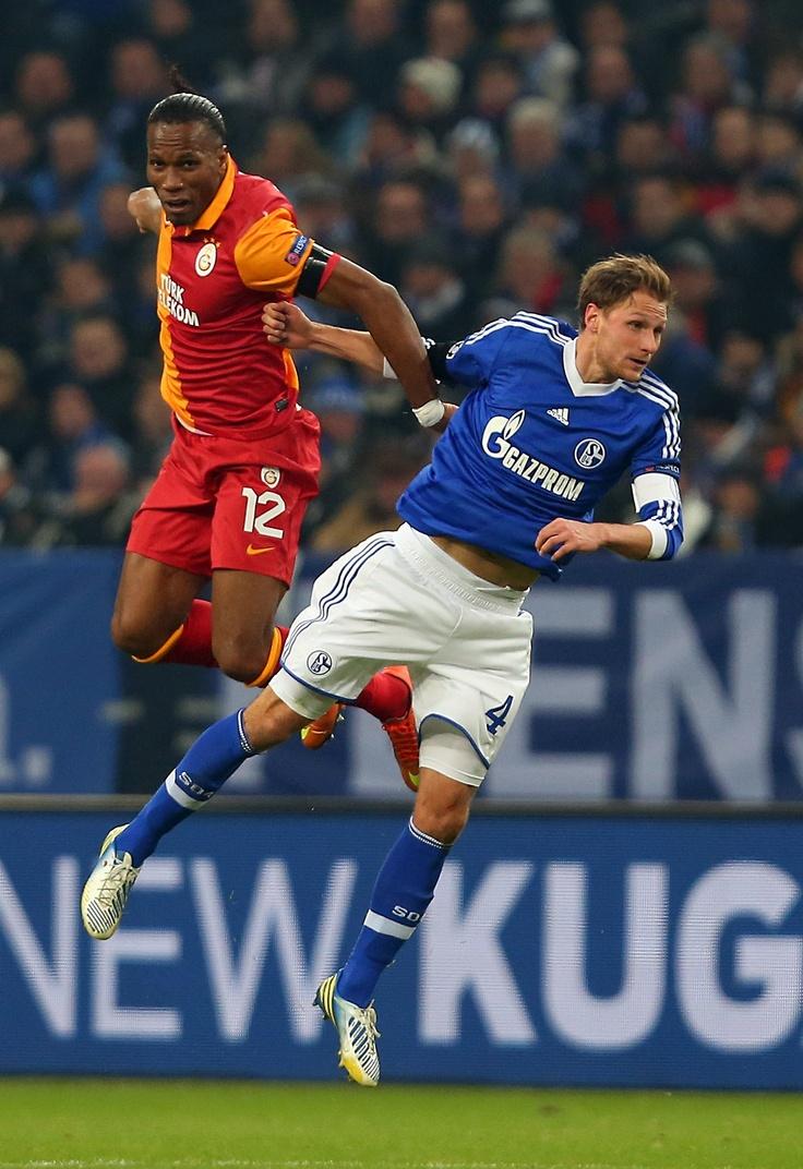 Didier Drogba and Benedikt Höwedes