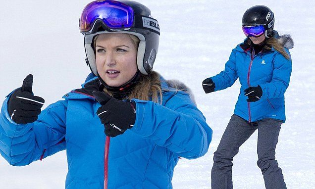 Miss Great Britain Zara Holland beams as she prepares for The Jump