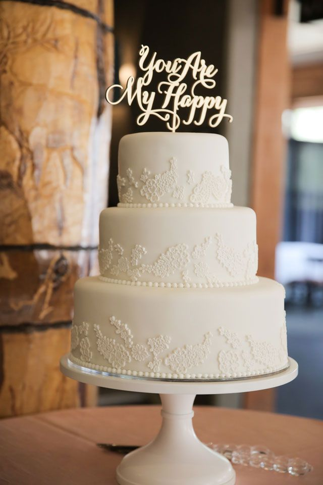 White round wedding cake with unique cake topper.   Photo by Pepper Nix Photography: http://www.peppernix.com || www.carriescakes.com