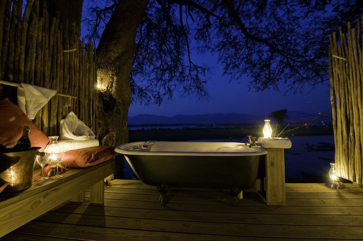 """Described as the """"bath with a view"""", position in completely private area of Ruckomechi Camp this scenic bath is one of the many highlights you will encounter. http://www.uyaphi.com/showcase/best-baths-in-africa.htm"""