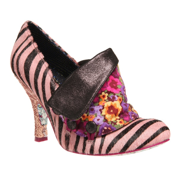 "You must check out the crazy shoes at ""Irregular Choice"".  Fun!"