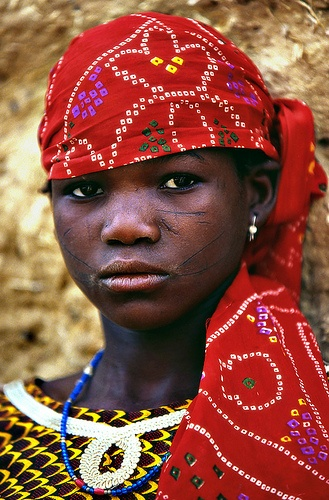 In the Niger women often where long colorful dresses to represent their tribal afflictions. Info from http://www.vagabondjourney.com/clothing-in-niger/
