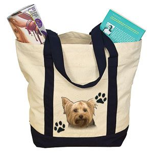 """Product # DC30008 - Lets everyone know the object of your canine devotion! Roomy, over-the-shoulder carry bag is made of durable cotton canvas and features a beautiful image of a Yorkie. Bag has exterior slash pocket, zippered top closure and is made from 100% natural cotton.18"""" W x 14"""" H x 7"""" D  $14.98"""