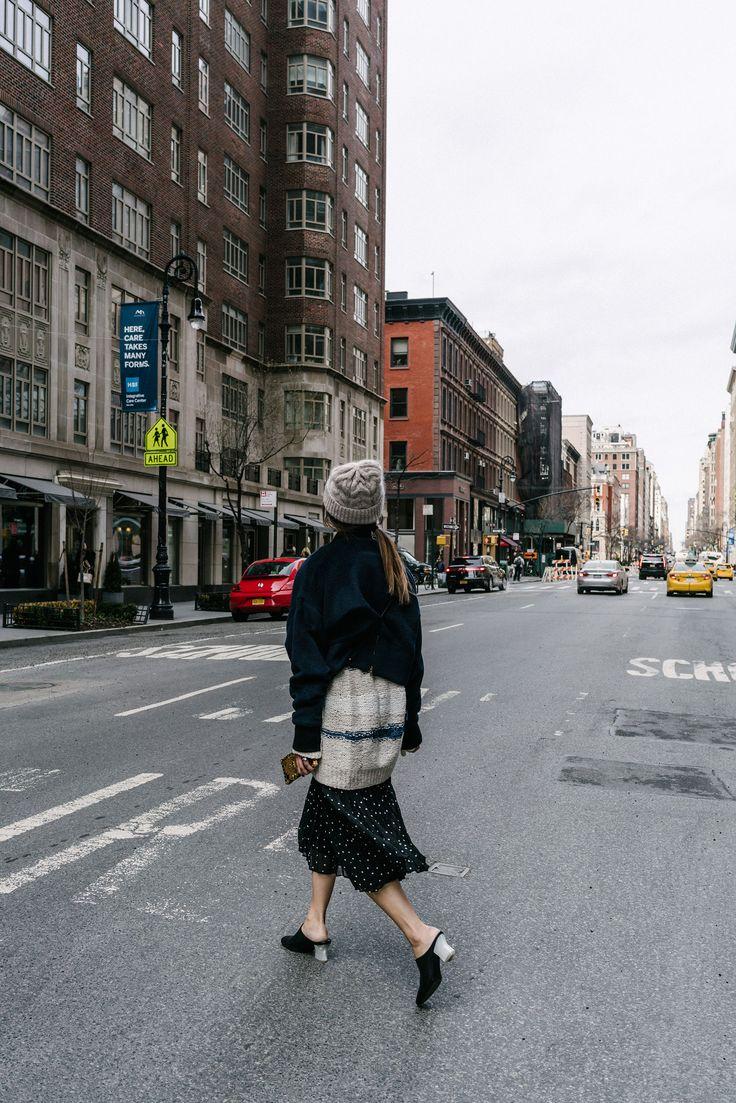 Cienne NY Jacket, Tomorrowland Sweater, Sézane Skirt, The Row Shoes, Loewe Bag, Louis Vuitton Case, COS Beanie via @eggcanvas
