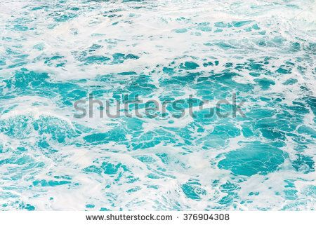 Beautiful turquoise coloured ocean water with sea foam suitable as background texture pattern.