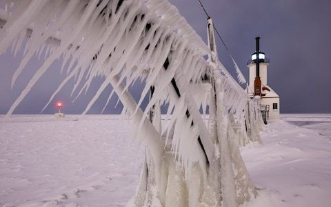 This photo was taken in Saint Joseph, Michigan which is located on the shore of Lake Michigan. Just prior to the start of the new year, the water on Lake Michigan was clear of ice. However strong wind  and extreme cold along with 'lake-effect snow' dramatically changed the landscape.