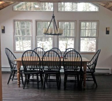 Dining room farmhouse table and modern Windsor chairs.    Www.chrunchydiva.com