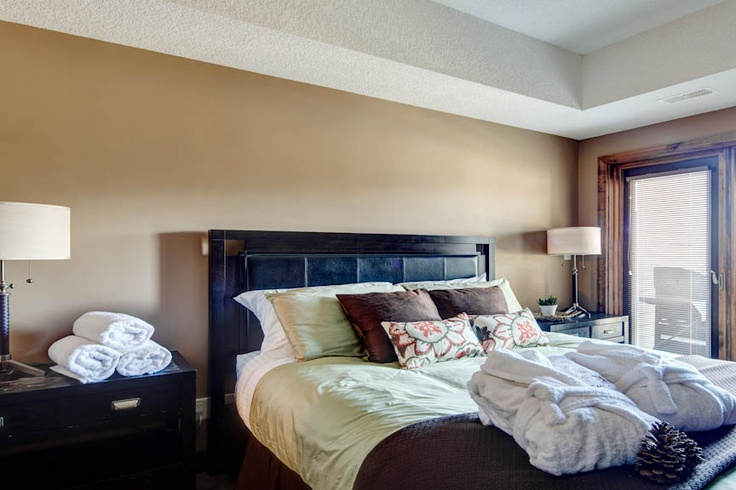 Comfortable master bedroom with pillowtop mattress, ensuite bathroom and french doors leading to the private 3rd floor sunny south deck.