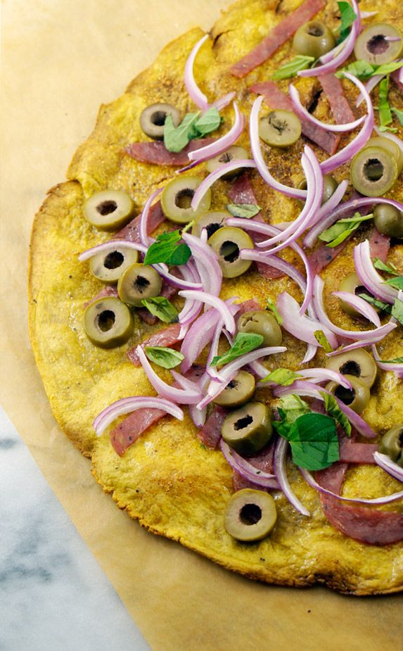 Thin + Crisp Italian Plantain Crust Pizza - plantain, sea salt, red onions, olives, salami, fresh basil, fresh oregano