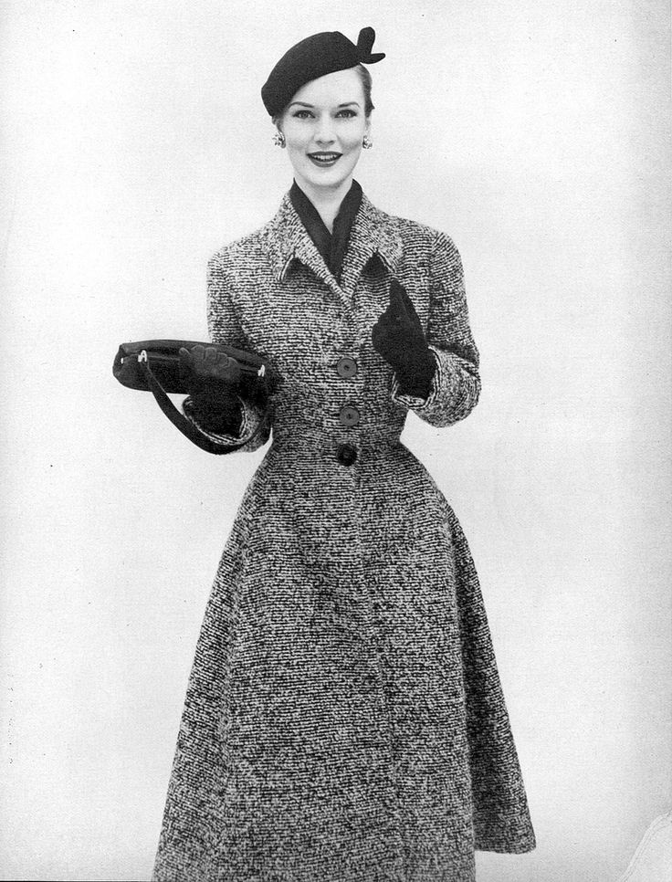 Model in tweedy coat with fitted waist and flared skirt from Vogue Pattern, Vogue, August 15, 1951