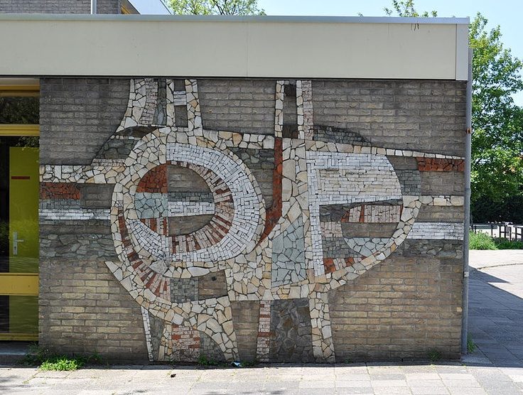 Abstract stone and ceramic mural on the exterior of a for Club de suscriptores mural