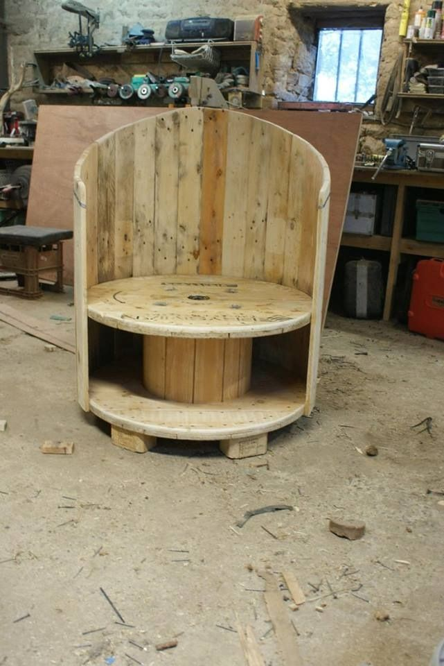 Outdoor chair made of a cable reel and pallet wood. So cool!