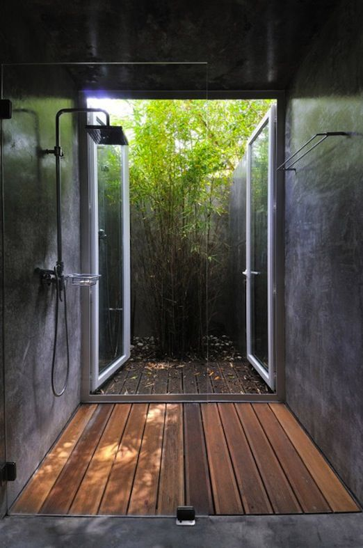 The wood creates a visual link with the foliage beyond the room and softens the effect of the solid surfaces. #bathrooms #showerroom #wetroom #wood #rustic #contemporary