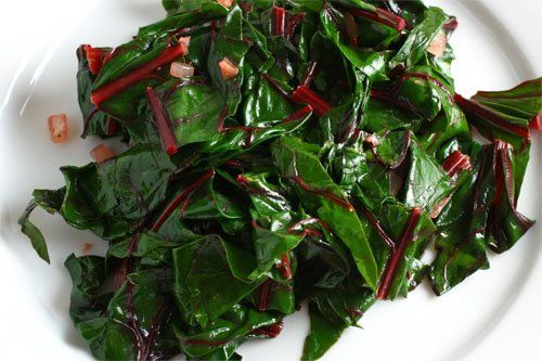 Simply saute some cleaned and chopped Swiss chard with some onions and garlic until it just wilts and you have a tasty and healthy green vegetable side dish that goes with almost any meal.