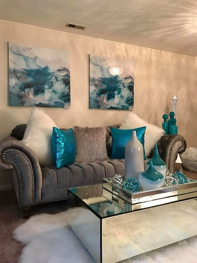 The Bright Blue Pillows Create Contrast In This Living Room Teal Living Rooms Living Room Turquoise Living Room Decor Cozy