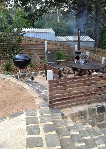 A wonderfully relaxing outdoor area, perfect for lazy barbecues with your very own outdoor antique wood-burning stove. The fencing was made from salvaged hardwood and the landscaping was native Australian Lomandra.