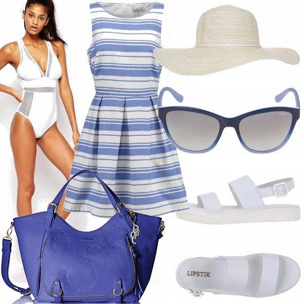 Un costume intero ma bianco, con inserti di rete, un abito classico a righe bianche e blu, il cappello di paglia bianco, occhiali da sole blu, sandali bassi e una borsa capiente blu. Perchè una lady rimane tale anche in spiaggia!
