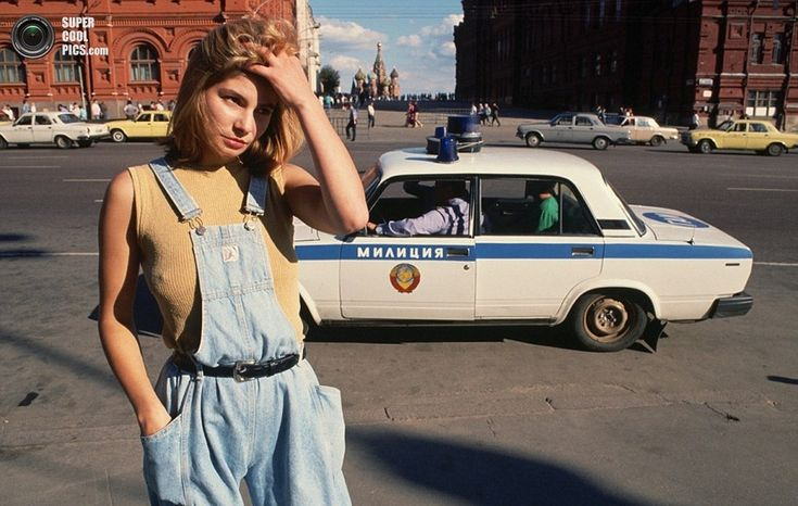 Eighteen-year-old prostitute Katya scours the street for work as a police car drives past in Moscow in 1991 shortly before the collapse of the USSR  Read more: http://www.dailymail.co.uk/news/article-2255693/Last-pictures-life-iron-curtain-collapse-USSR.html#ixzz2tgaEqmFa