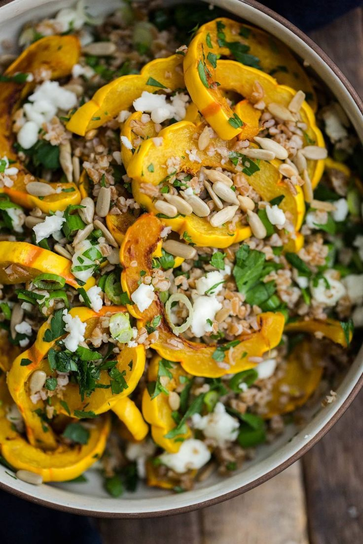 An easy salad with roasted delicata squash, bulgur, goat cheese, and a light lemon dressing. Roast the squash ahead of time for easy assembly! // @NaturallyElla
