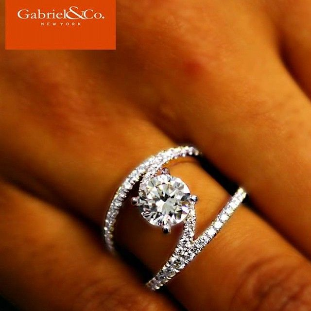 This unique 14k diamond split shank engagement ringDiscover this gorgeous engagement ring or customize your own at Gabriel & Co.