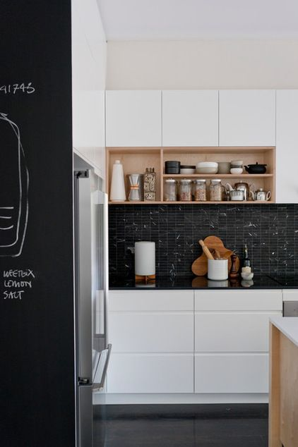 White handle-less, gloss, with thin black worktop and nice light wood open shelves